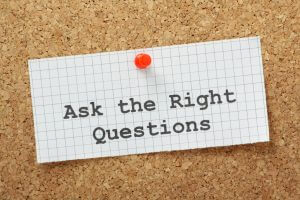 "Note on bulletin board reading ""Ask the Right Questions"", the clarification of VOC research"
