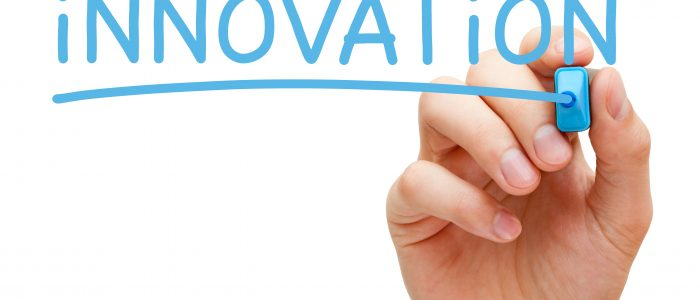 "Hand writiing ""innovation"" in blue marker, alluding to the back end of innovation strategy"
