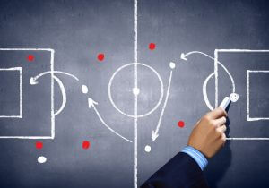 Soccer strategy on chalkboard, representing learning tactics from B2C researchers