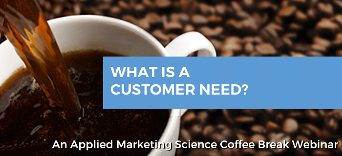 "Coffee cup with the banner ""what is a customer need"""