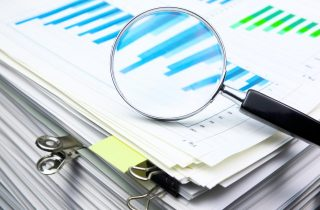 Magnifying glass viewing charts, portraying conjoint market research
