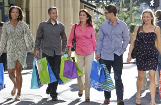 Diverse group of consumers walking, representing voice of the customer